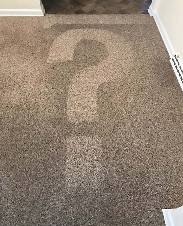 question mark on carpet